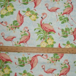 Wilmington Flamingos and flowers on a patterned lt blue background