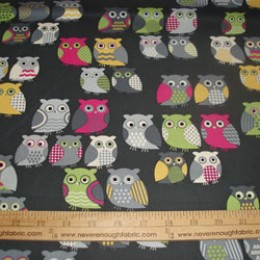 "Cotton Blend 58/60"" wide OWLS in pink green and yellow on dark gray (72)"