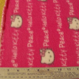 Fleece Hello Kitty winking on pink peace