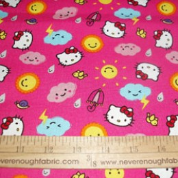 Hello Kitty Cotton Fabric Rain or Shine Collection clouds and suns on pink