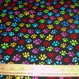 Loralie Designs bright colored tossed paws on black