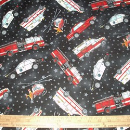 Cotton Fabric Emergency Vehilces on black with stars