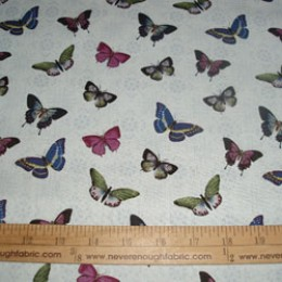 Cotton Fabric Blue Notes Wild Apple all over butterflies on lt blue