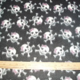 Fleece Fabric Girly Skulls on black with a pink bow on skull