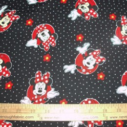 Disney's Minnie Mouse on black with white polka dots