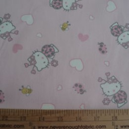 Hello Kitty as a ladybug on light pink