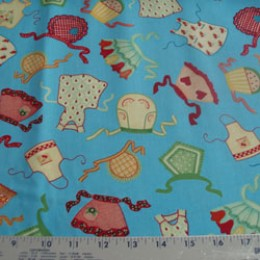 Mary Engelbreit Kitchen Capers Aprons on blue